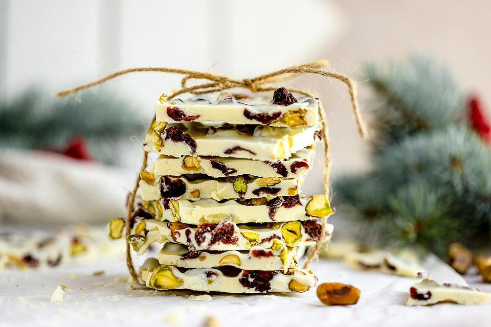 Food blogger, Bella Bucchiotti of xoxoBella, shares a recipe for cranberry and pistachio which chocolate bark. You will love this easy holiday treat recipe that is like almond bark.