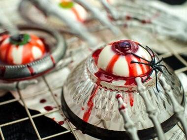 Food blogger, Bella Bucchiotti of xoxoBella, shares a recipe for Halloween panna cotta eyeballs. This is a gluten free Halloween dessert that looks like eyeballs.