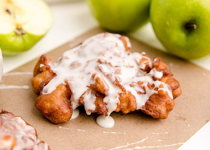 Food blogger, Bella Bucchiotti of xoxoBella, shares a recipe for homemade apple cinnamon fritters. Learn how to make apple fritters or fried apple donuts.
