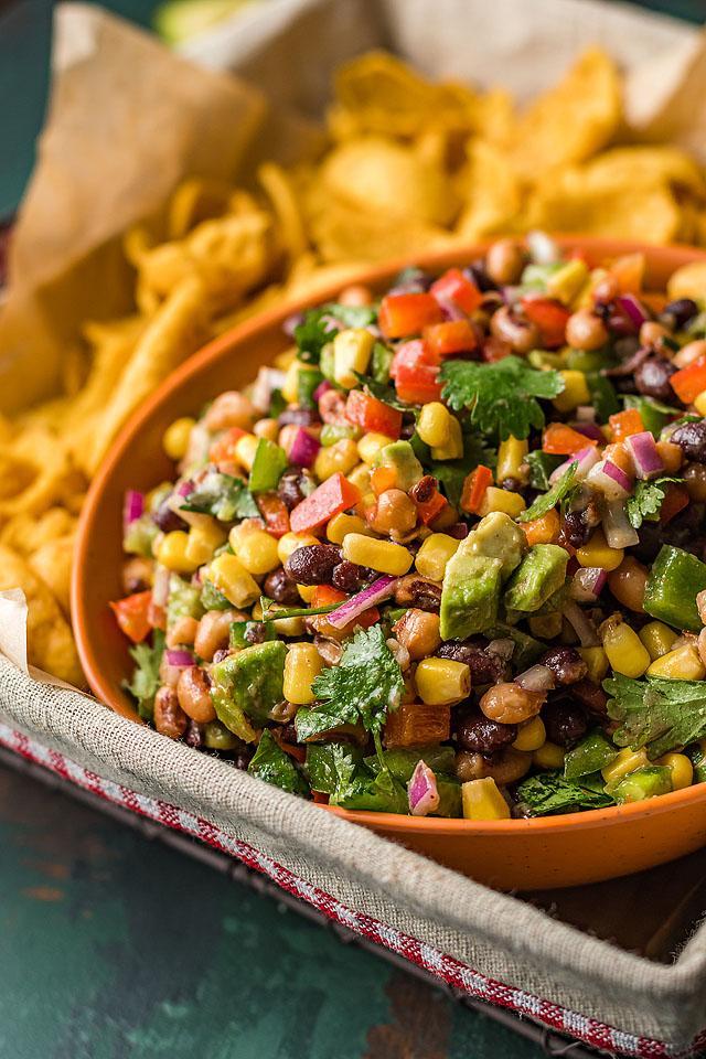 Food blogger, Bella Bucchiotti of xoxoBella, shares a recipe for Texas cowboy caviar dip. You will love this healthy summer BBQ dip.