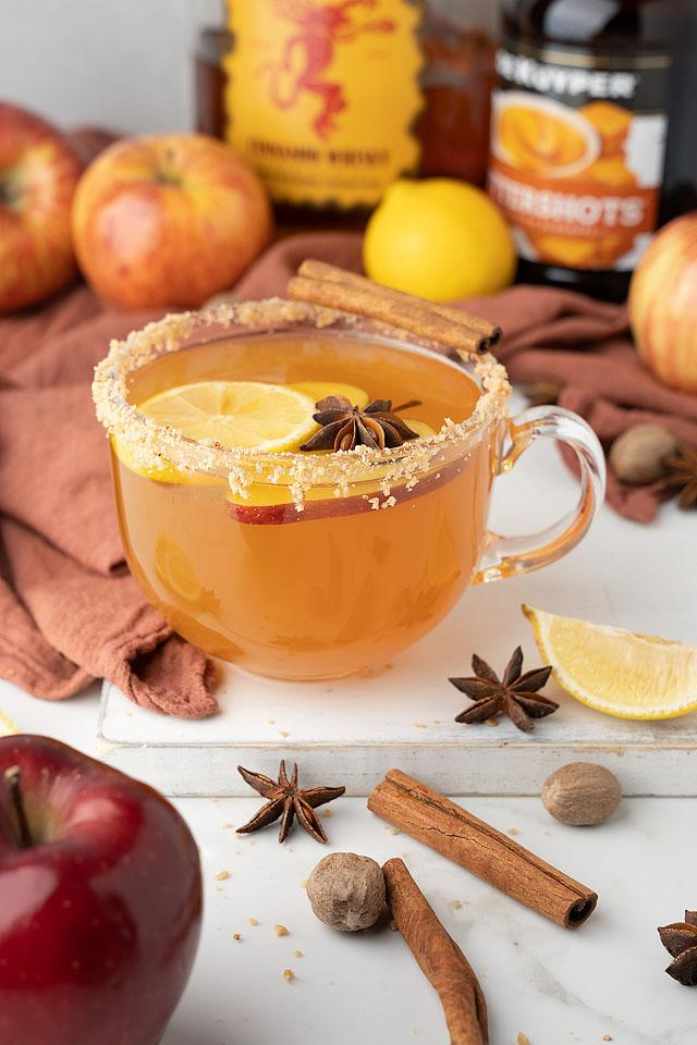 Food blogger, Bella Bucchiotti of xoxoBella. shares a recipe for toffee apple cider Fireball hot toddy. You will love this cocktail with apple cider and Fireball whiskey.