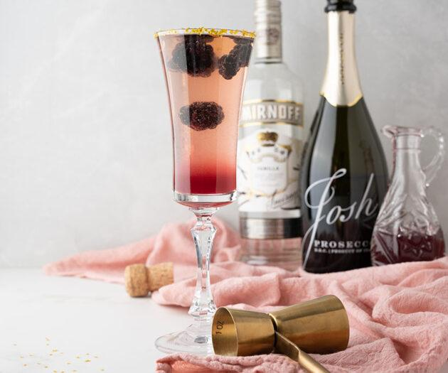Food blogger, Bella Bucchiotti of xoxoBella, shares a recipe for a Meyer lemon blackberry jam Prosecco cocktail. This simple Prosecco drink is a great Christmas or New Year's Eve cocktail.