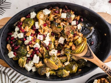 Food blogger, Bella Bucchiotti of xoxoBella, shares a recipe for roasted brussels sprout pomegranate pancetta feta casserole. It is a delicious Autumn or Thanksgiving side dish.