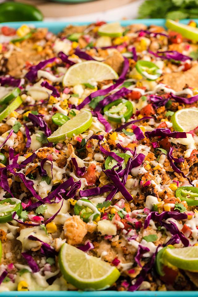 Food blogger, Bella Bucchiotti of xoxoBella, shares a recipe for sheet pan blackened tilapia baja fish nachos. You will love this seafood nachos recipe.