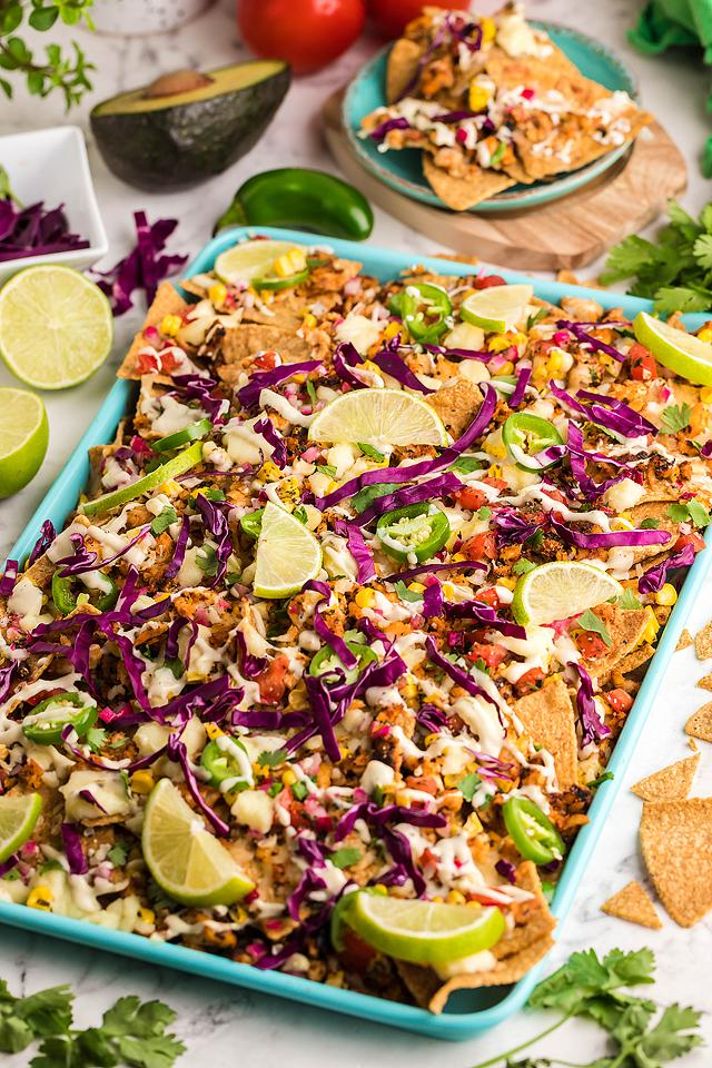 Food blogger, Bella Bucchiotti of xoxoBella, shares a recipe for sheet pan blackened tilapia baja fish nachos. You will love these baked loaded nachos and topping ideas.