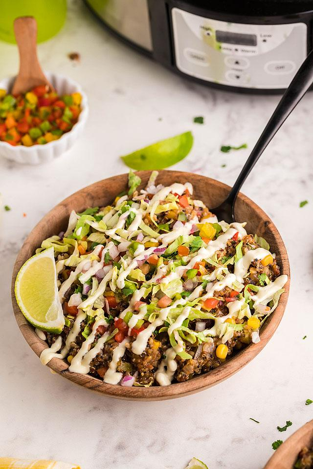 Food blogger, Bella Bucchiotti of xoxoBella, shares a recipe for slow cooker Tex Mex quinoa taco bowls. You will love this vegan southwest inspired taco bowl.