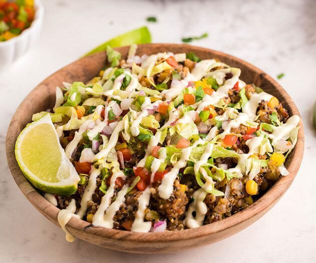 Food blogger, Bella Bucchiotti of xoxoBella, shares a recipe for slow cooker Tex Mex quinoa taco bowls. You will love this vegan crockpot Mexican quinoa.