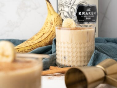 Food blogger, Bella Bucchiotti of xoxoBella, shares a recipe for spiked bananas foster ice cream rum nog. You will love this Christmas banana cocktail made with black spiced rum.
