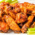 Food blogger, Bella Bucchiotti of xoxoBella, shares a recipe for air fryer BBQ peach bourbon wings. You will love this easy air fryer chicken recipe.