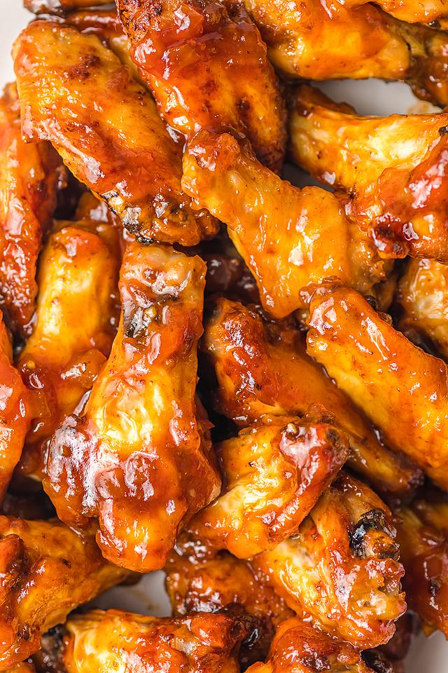 Food blogger, Bella Bucchiotti of xoxoBella, shares a recipe for air fryer BBQ peach bourbon wings. You will love these peach wings!