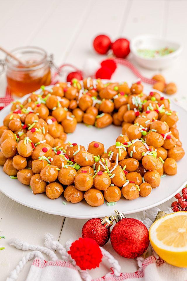 Food blogger, Bella Bucchiotti of xoxoBella, shares a dessert recipe for homemade Italian struffoli or tasty Christmas honey balls.