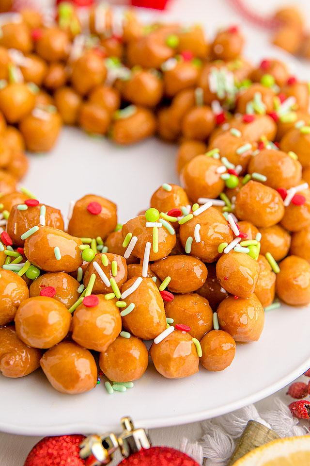 Food blogger, Bella Bucchiotti of xoxoBella, shares a dessert recipe for homemade Italian struffoli. You will love these fried dough balls with honey glaze and sprinkles.