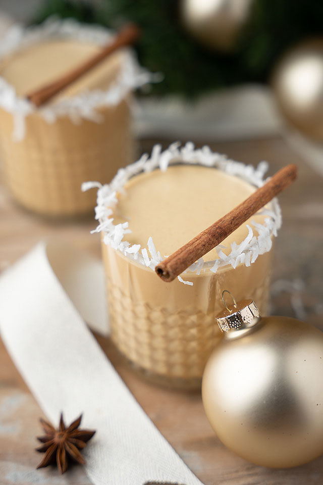 Food blogger, Bella Bucchiotti of xoxoBella, shares a cocktail recipe for eggless coquito con dulce de leche or Puerto Rican rum eggnog. This is the best coquito recipe!